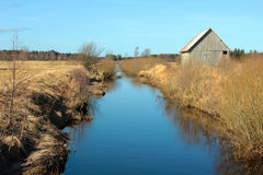 A barn by the water canal Stock Image