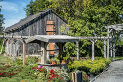 Barn Well And Flowers Stock Image