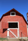 Barn and white barn against the bluest blue sky Royalty Free Stock Photo