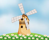 A barn with a windmill Royalty Free Stock Photo