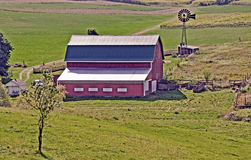 Barn and windmill near Madison, Wisconsin. Traditional red barn on family farm in Wisconsin Royalty Free Stock Photos