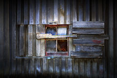 Barn Window. Close up detail of window in side of old timber barn building on farm Stock Photos