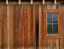 Barn and window. Side of a wooden barn with planks and window Stock Image