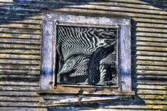 Barn Window. An HDR image of barn's window in disrepair Stock Image