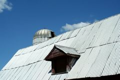 Barn window with silo Stock Images