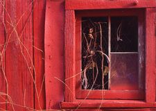 Barn window in winter. Barn window in red barn Royalty Free Stock Images