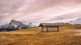 Barn in windswept mountain landscape