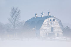 Barn in Winter Fog Royalty Free Stock Photography