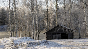 Barn by a river in winter Royalty Free Stock Photography
