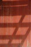 Barn Wood. Weathered barn with open overhang shadow Stock Image