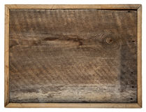 Barn wood board. Rough blank barn wood board sign with a frame isolated on white royalty free stock image
