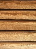 Barn wood slats. Exterior wood siding with a rustic vintage aged wooden brown look Stock Photography