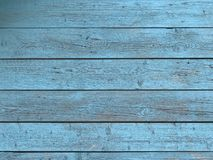 Barn wood wall with distressed, peeling blue paint. Horizontal planks Stock Photos
