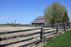 Barn and wooden fence Stock Images