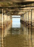 Barnacle Covered Pillars of an Ocean Fishing Pier Stock Photos