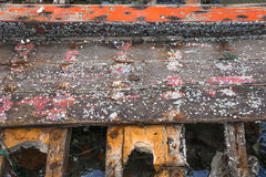 Barnacles on wooden wreckage boat. Piece of wreckage boat in the sea, barnacles on wooden boat Stock Photos