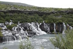 Barnafossar iceland. Barnafoss is also known as Bjarnafoss, which was its previous name. Barnafoss is near Hraunfossar which burst out of Hallmundarhraun which Royalty Free Stock Photography