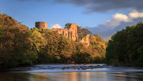 Barnard Castle. A view of the castle in the town of Barnard Castle, County Durham. Taken from the river Tees at sunset stock photography