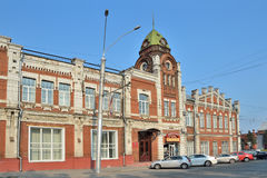 Barnaul, Russia, August, 17, 2016. Cars are near the building of the Barnaul city Duma 1914-1916 years of construction in summer Royalty Free Stock Photo
