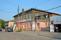 Barnaul, Russia, August, 17, 2016. Man walking near old wooden house on the street of Lev Tolstoy in Barnaul Stock Photo