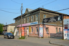 Barnaul, Russia, August, 17, 2016. Man walking near old wooden house on the street of Lev Tolstoy in Barnaul Royalty Free Stock Photography