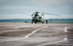 Barnaul,Russia-17 Jul 2018.The pilot and the aircraft are on the background of military transport helicopter royalty free stock image