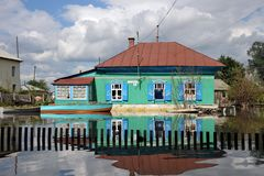 Flood. The river Ob, which emerged from the shores, flooded the outskirts of the city.Boats near the houses of residents. Royalty Free Stock Photography