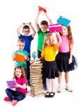 Barnen är intresserade i böcker Royaltyfria Foton