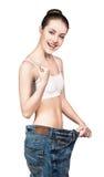 Barnet bantar kvinnan i överdimensionerad jeans Royaltyfria Foton