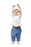 Barnet behandla som ett barn anseendet som applåderar och ler inomhus Fotografering för Bildbyråer