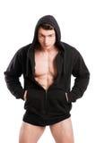 Barnet dubbar den bärande svarta hoodien och underkläderna royaltyfri foto