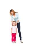 Barnet fostrar och hennes lilla dotter som isoleras på vit arkivbilder