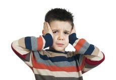 Barnet har huvudvärk arkivfoton