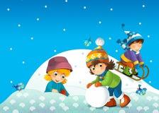 Barnet i vintern på pulkan Arkivbilder