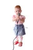 barnet lyssnar musik till Royaltyfria Foton
