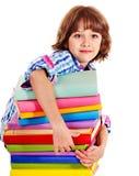 Barnet med bunten av bokar. Arkivbild