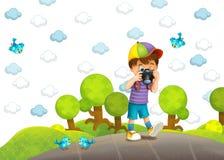 Barnet med kameran Royaltyfri Foto
