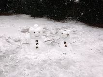 Couple of Snowmen in London stock images
