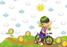 Barnet på cykeln Arkivfoto