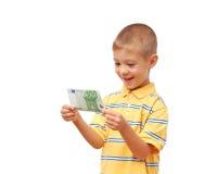 barnet rymmer pengar Arkivbild