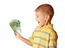 barnet rymmer pengar Fotografering för Bildbyråer