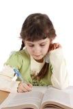Barnet skriver och läser. Arkivbilder