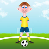 Barnet startar fotbollmatchen Arkivfoton