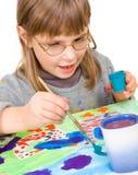 barnet tecknar arkivfoto