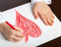 barnet tecknar royaltyfri fotografi