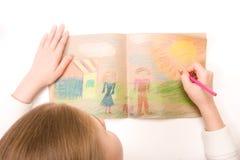 barnet tecknar Arkivbilder