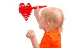 barnet tecknar rött litet för hjärta royaltyfria foton