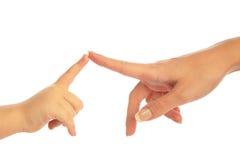 barnfingrar mother att trycka på Fotografering för Bildbyråer