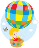 Barnflyg på en ballong Arkivbild