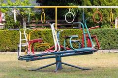 Barnkarusell i lekplats Arkivbild
